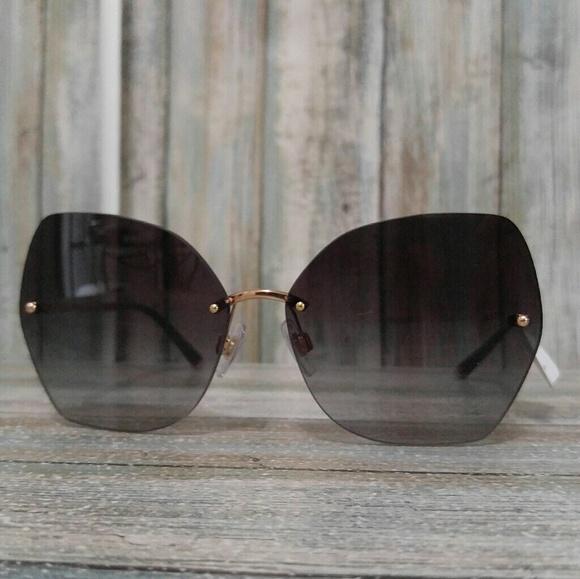3c4dd07b46be Dolce   Gabanna Rimless Oversized Glasses DG2204
